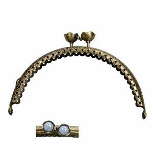 Portemonnee sluiting 10,5cm brons met bloemknop in lichtblauw